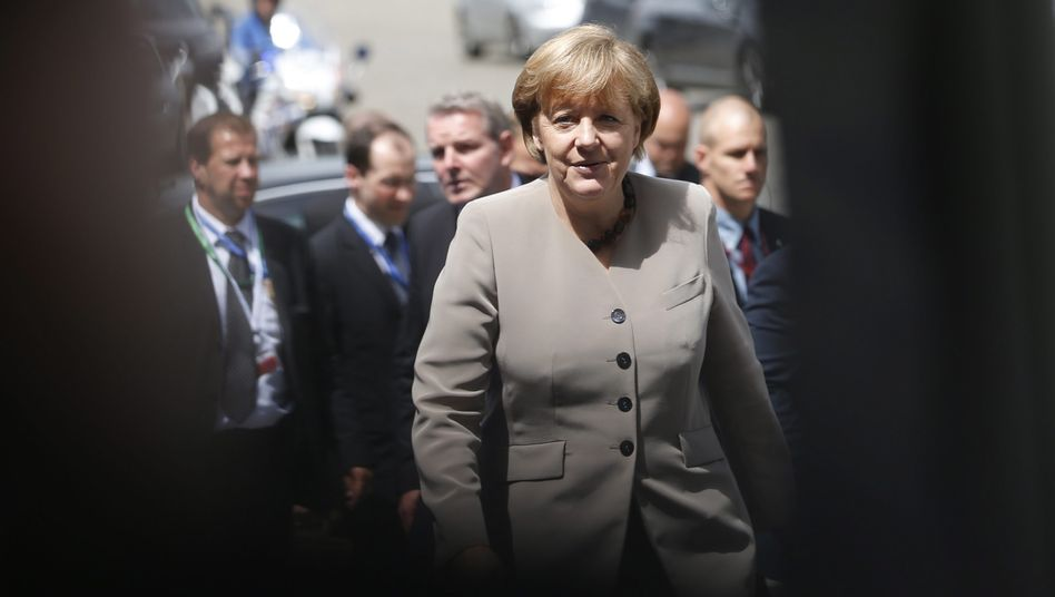 Chancellor Merkel arrives for a meeting of the European People's Party in Brussels ahead of the European Union summit on Thursday.