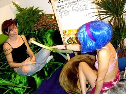Johansson instructing a volunteer on the finer points of eco-porn.