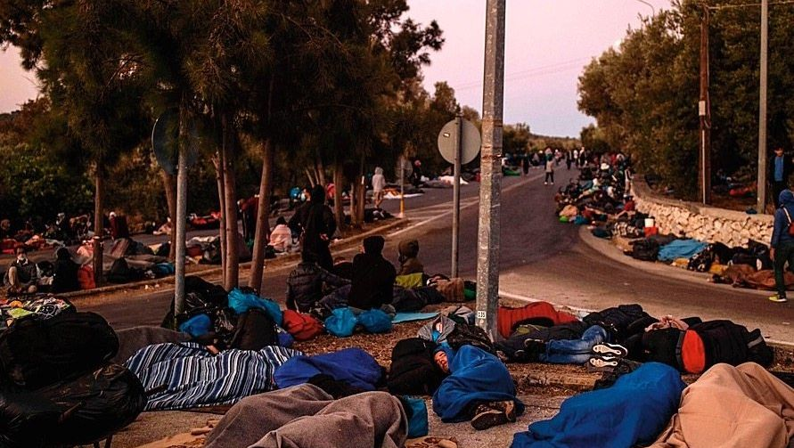 An inhumane system: Homeless refugees from Camp Moria sleep next to a road on the Greek island of Lesbos