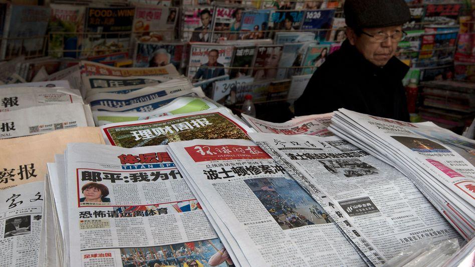 Zeitungsstand in Peking: Ungewöhnliche Forderung an die Mächtigen