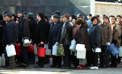 Lining up for water in Harbin, China. Water was flowing again on Tuesday.