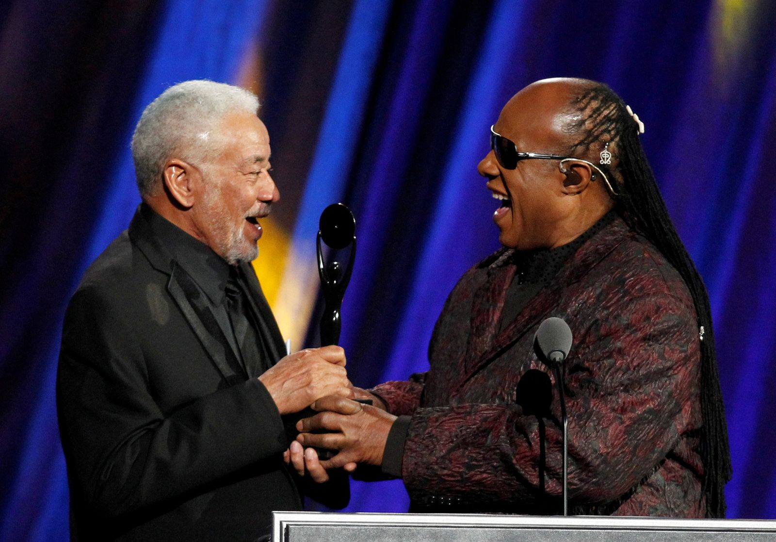 FILE PHOTO: Musician Withers is inducted by Wonder during the 2015 Rock and Roll Hall of Fame Induction Ceremony in Cleveland