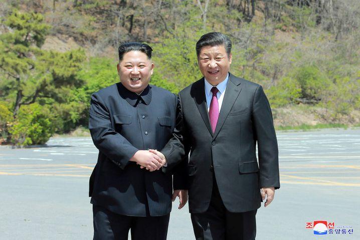 Kim und Xi in China