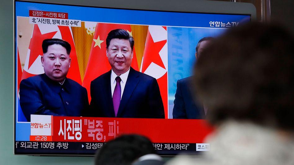 Kim Jong Un (l.) und Chinas Präsident Xi Jinping