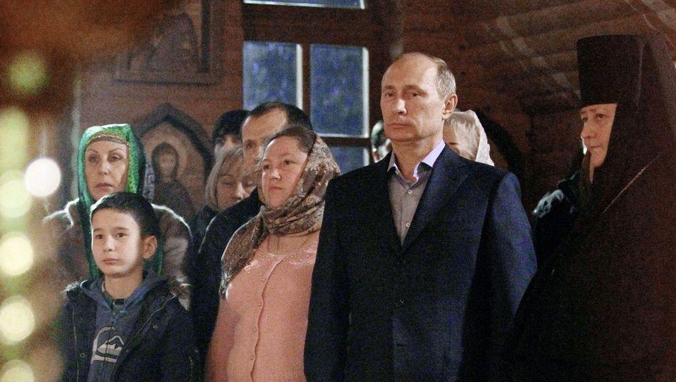 Russian President Vladimir Putin at a Christmas service in Sochi.