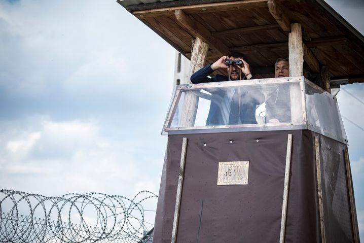 Fortress Europe has many architects: Italian Interior Minister Matteo Salvini (left) using binoculars next to Hungarian Prime Minister Viktor Orban from a watch tower along the fence on the Hungarian-Serbian border.