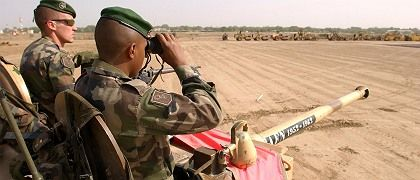 "French soldiers securing the area around the airport of N""Djamena last Friday. On Tuesday President Nicolas Sarkozy said that France was prepared to intervene to protect Chad's President Idriss Deby."