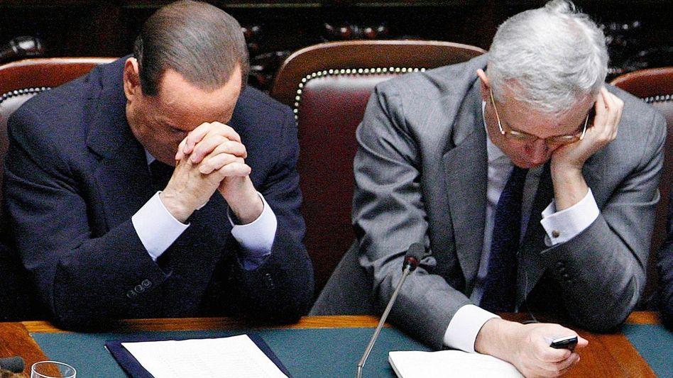 Regierungspartner Berlusconi, Tremonti: Munter intrigiert