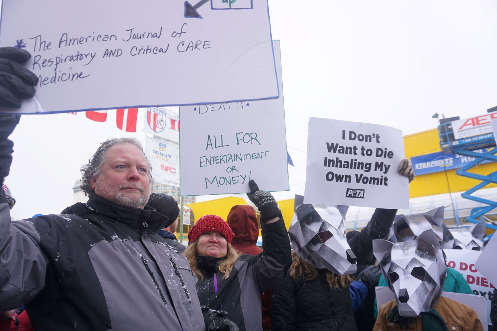 Pat Hartley and Jessica Hartley of Anchorage, representing People for the Ethical Treatment of Animals (PETA), protest at the Anchorage ceremonial start of the 2020 Iditarod Trail Sled Dog Race