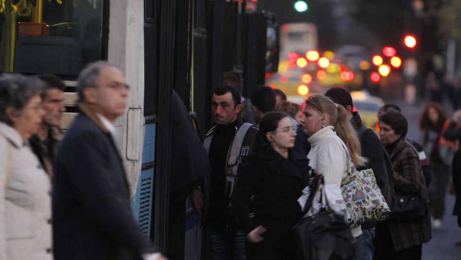 People waiting for the bus in Athens on Wednesday.