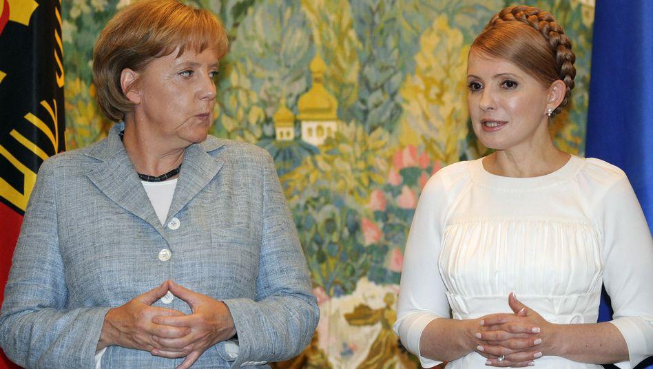 Merkel, Timoschenko (Archivbild von 2008): Sorgen um die Zukunft der Ukraine