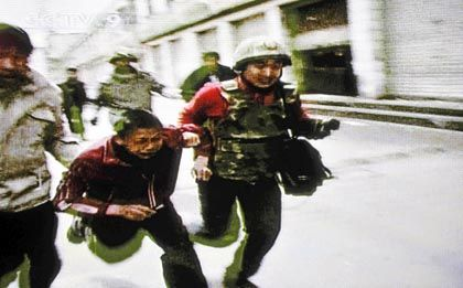 Is this boy in Lhasa being arrested -- or escorted by Chinese authorities? This AFP photo -- a framegrab from Chinese state television -- was the subject of criticism by Chinese authorities after it was used in Western media as a symbol of the Chinese crackdown.
