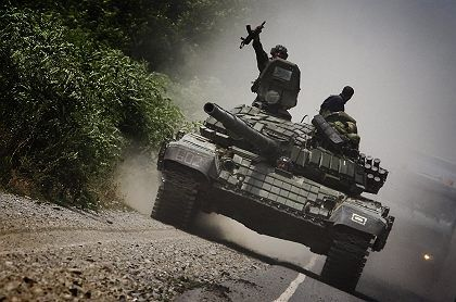 Georgian tanks heading for the South Ossetian front on Monday.