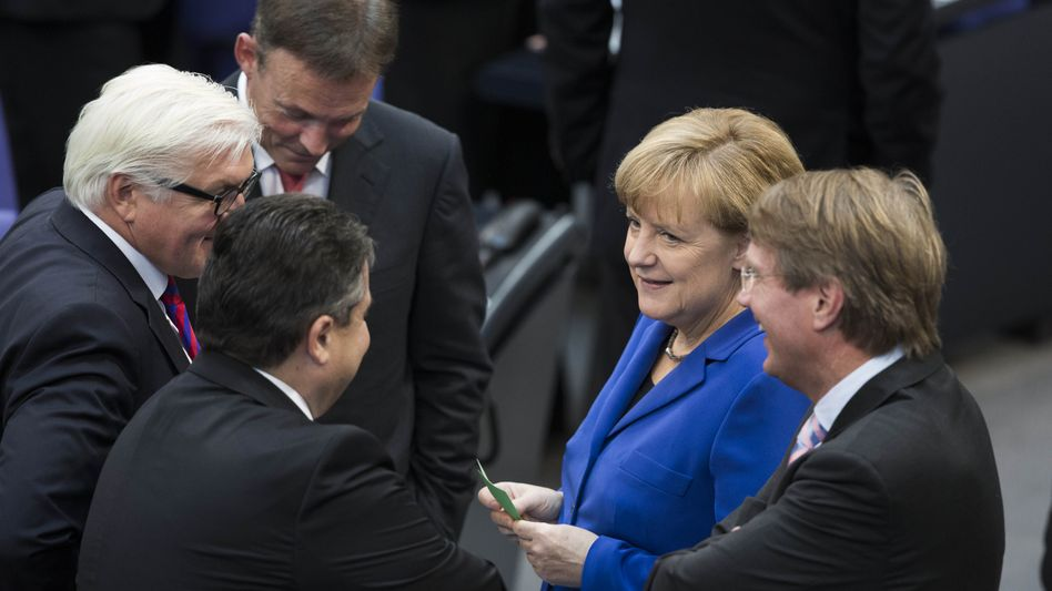 Merkel meets with conservatives and Social Democrats in Berlin.
