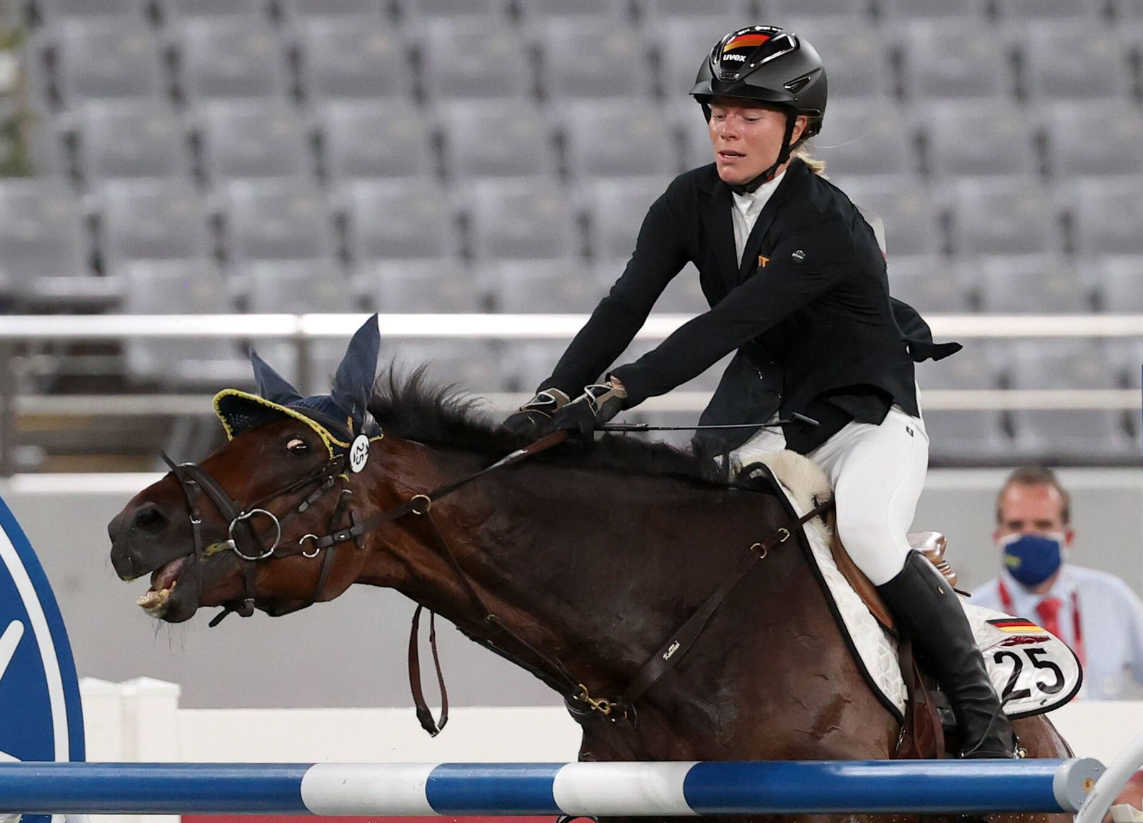 TOKYO, JAPAN - AUGUST 6, 2021: Germany s Annika Schleu competes in the women s individual riding show jumping event duri