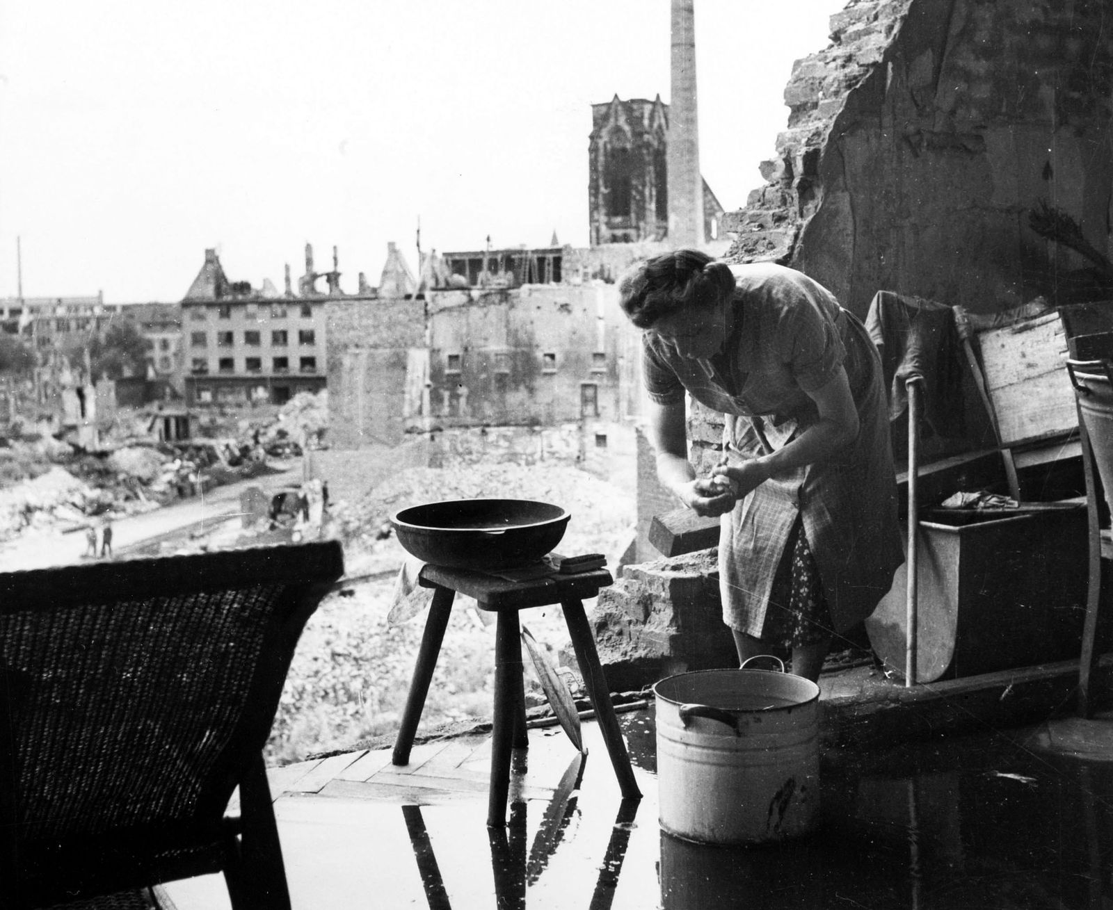 War and Conflict. Post World War Two. Germany. pic: circa 1946. A German woman carries on with her work amid the ruins of Essen in the Ruhr.