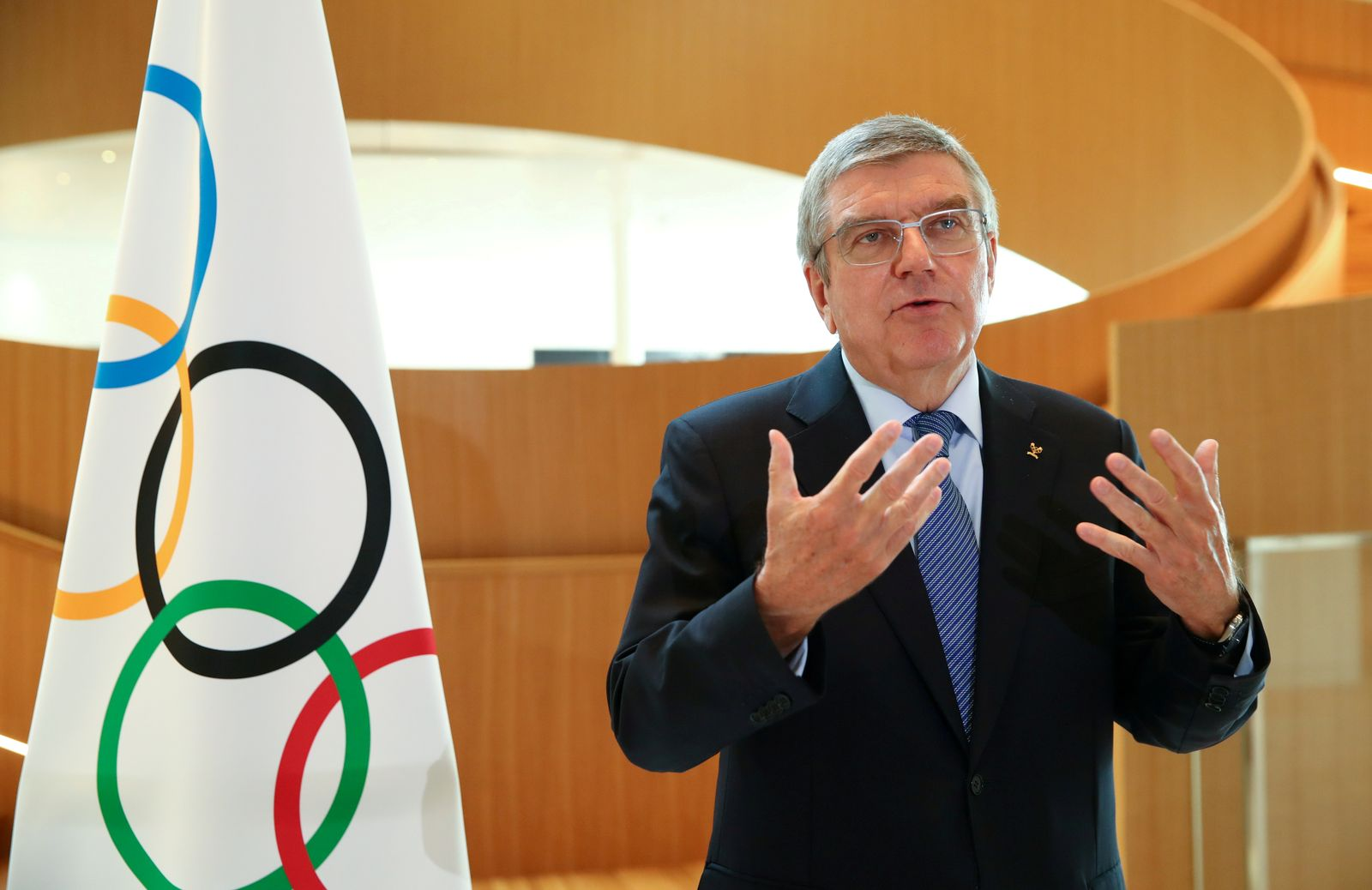 FILE PHOTO: Thomas Bach, President of the International Olympic Committee (IOC) attends an interview after the decision to postpone the Tokyo 2020 because of the coronavirus disease