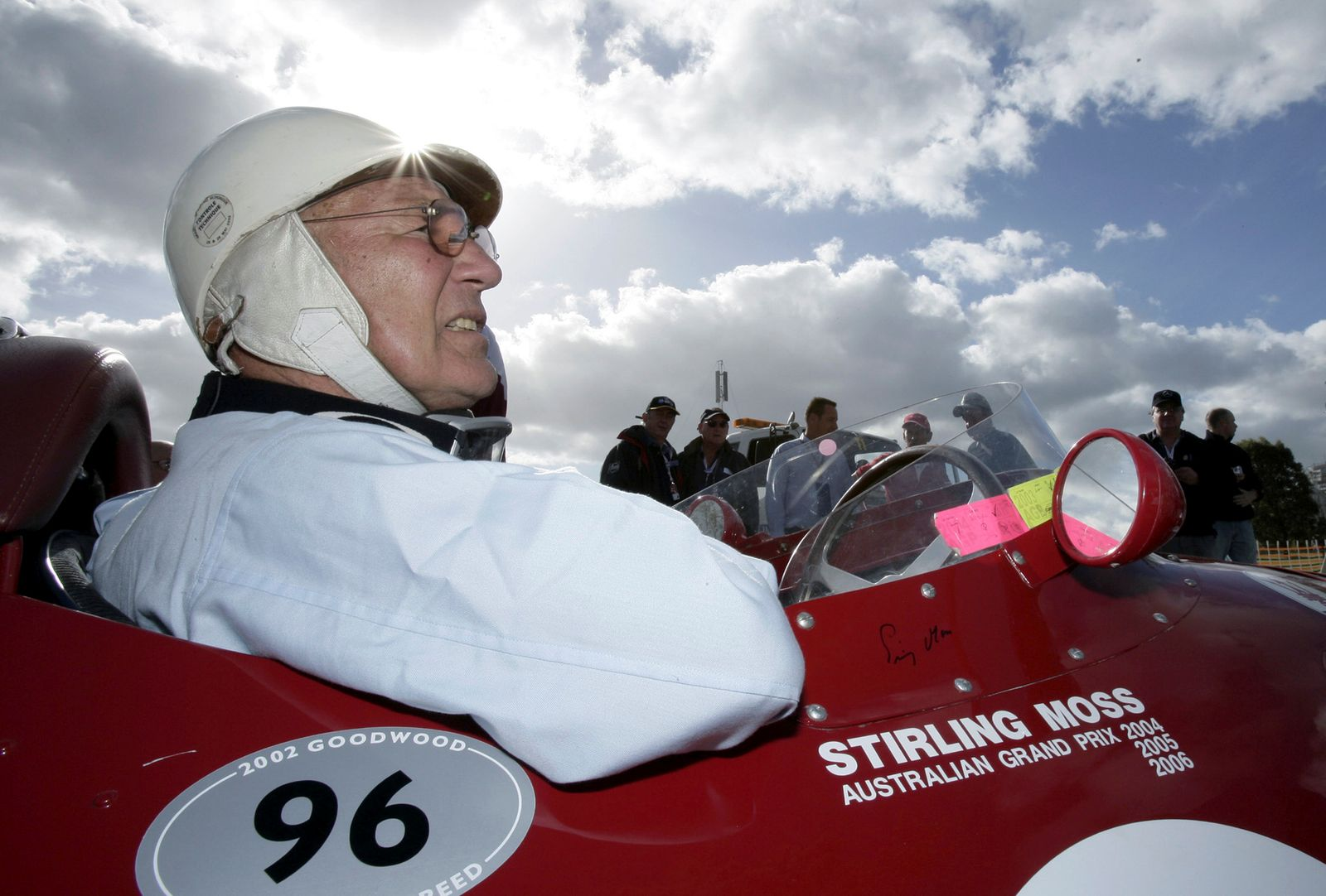 FILE PHOTO: Stirling Moss sits in a Maserati replica Formula One car in Melbourne in this April 2, 2006 file photo