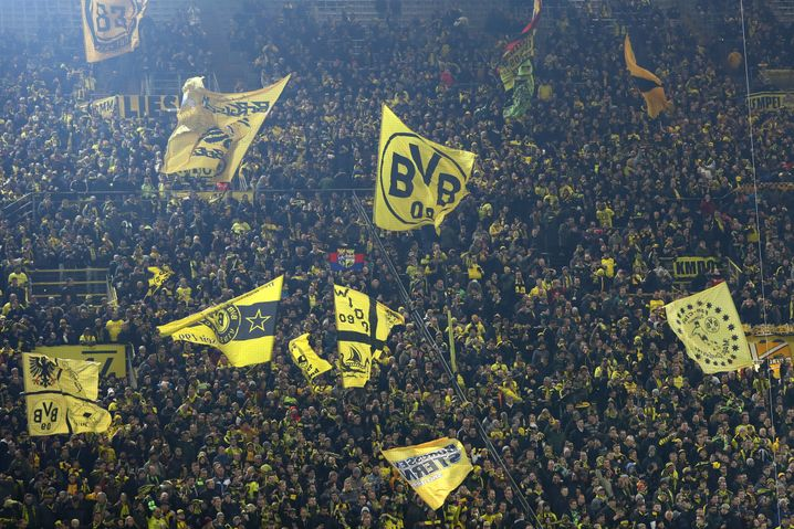 Fans at a Borussia Dortmund match: the bedrock of football in Germany