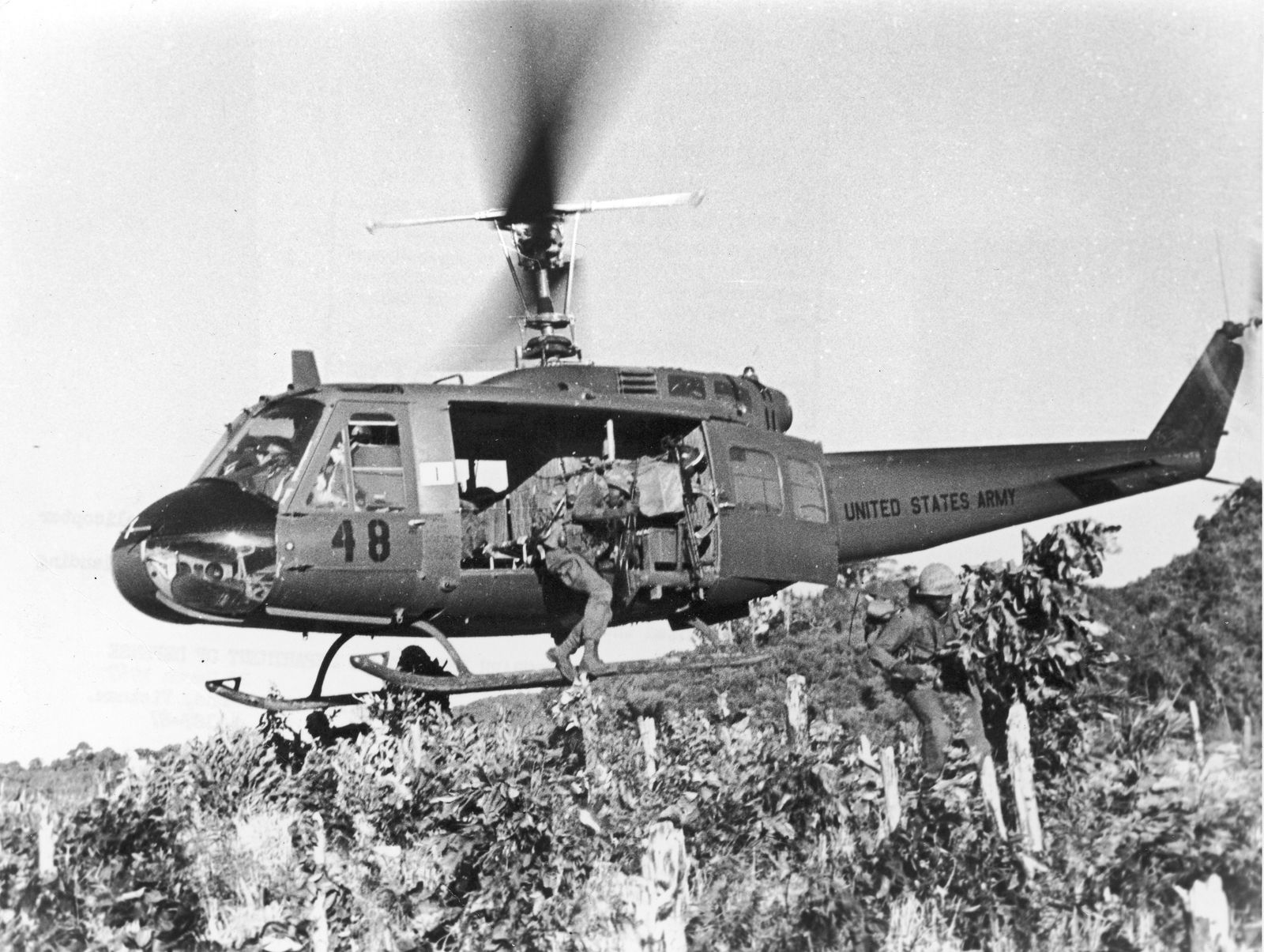 Michael Verhoeven - Soldiers Jumping From Helicopter in Air Strike, Vietnam, 1967.
