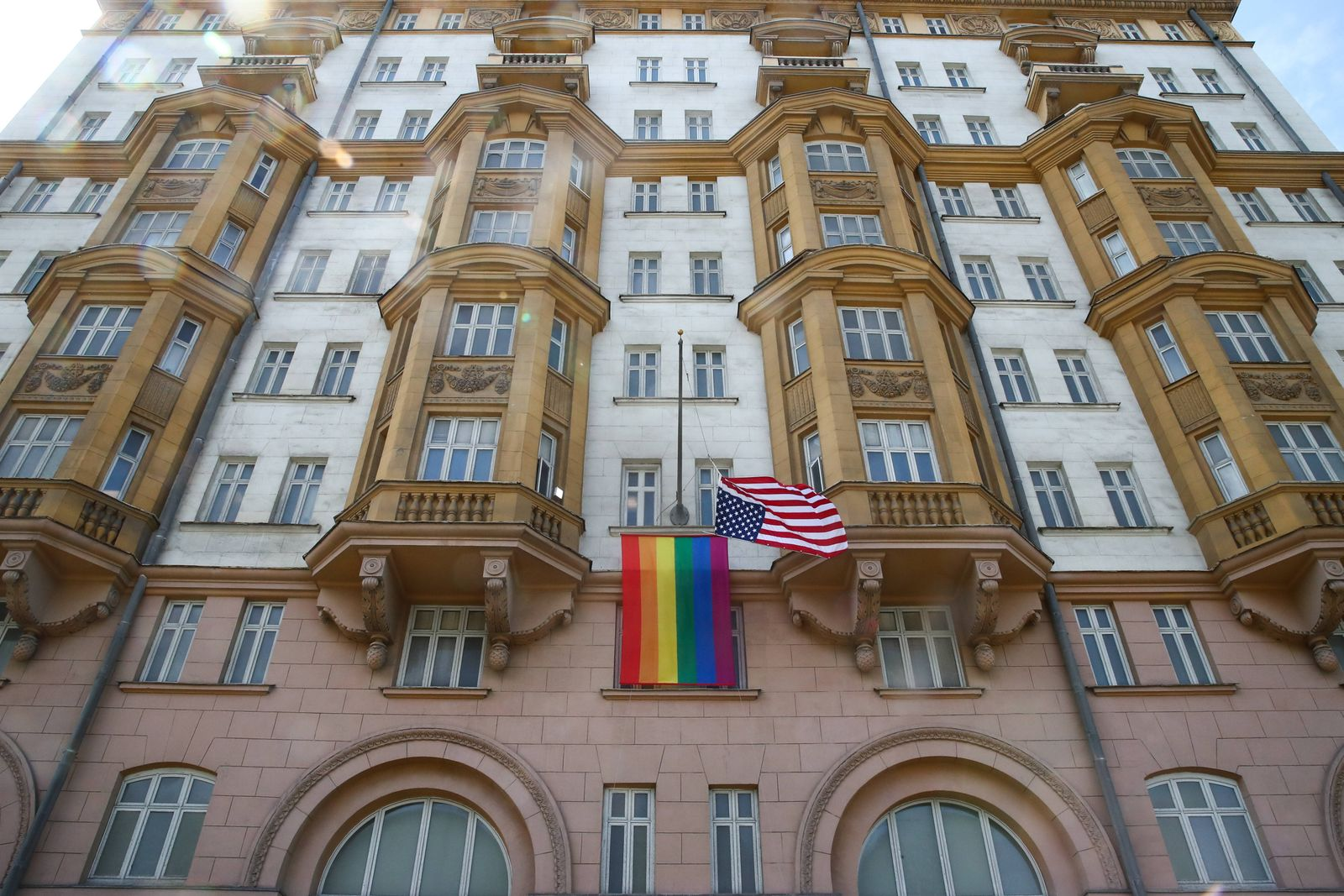 MOSCOW, RUSSIA - JUNE 25, 2020: The US national flag and an LGBT pride flag on the front facade of the US Embassy in Mo
