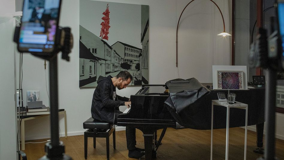 Igor Levit playing a house concert during the coronavirus lockdown in his Berlin apartment.