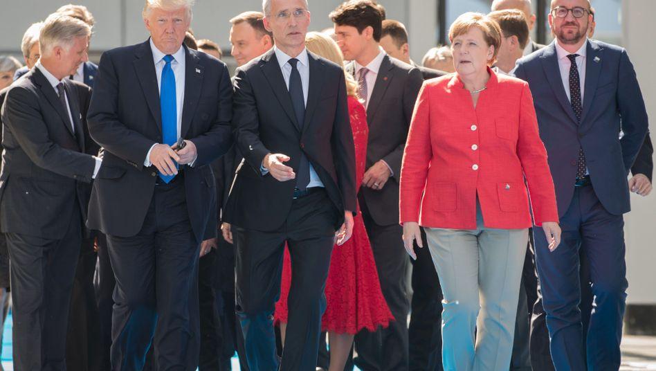 Donald Trump, Nato-Generalsekretär Jens Stoltenberg, Angela Merkel