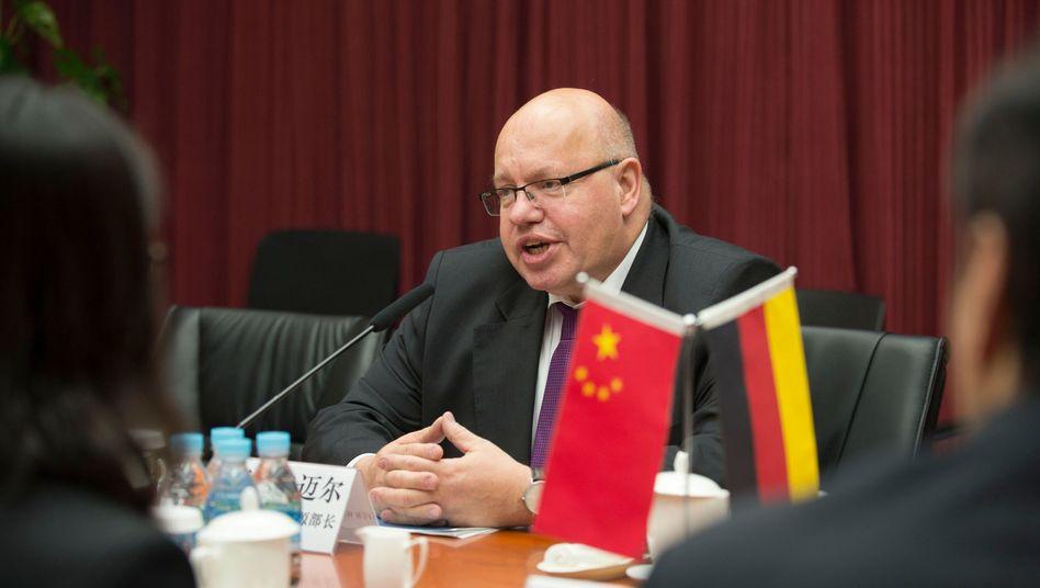 Bundeswirtschaftsminister Peter Altmaier (CDU) bei einem Gipfeltreffen in Peking
