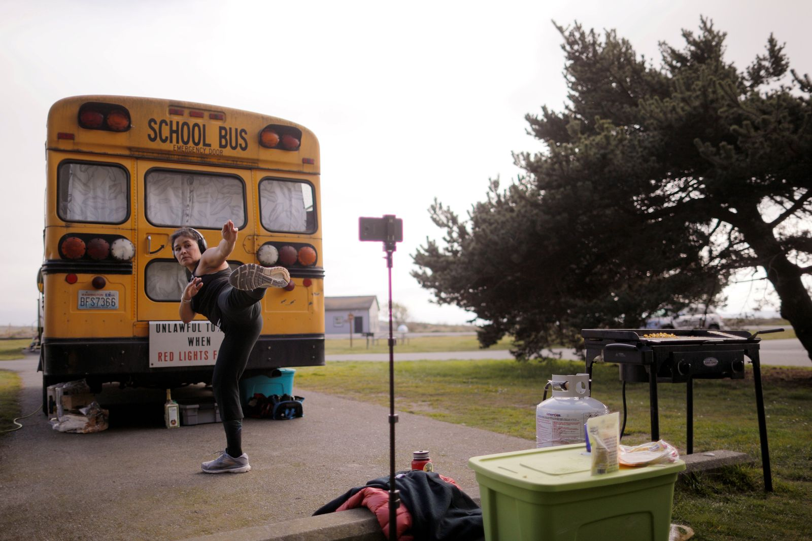 Gina Mares Kurtz takes part in a virtual kung fu class while camping at Fort Worden State Park in Port Townsend