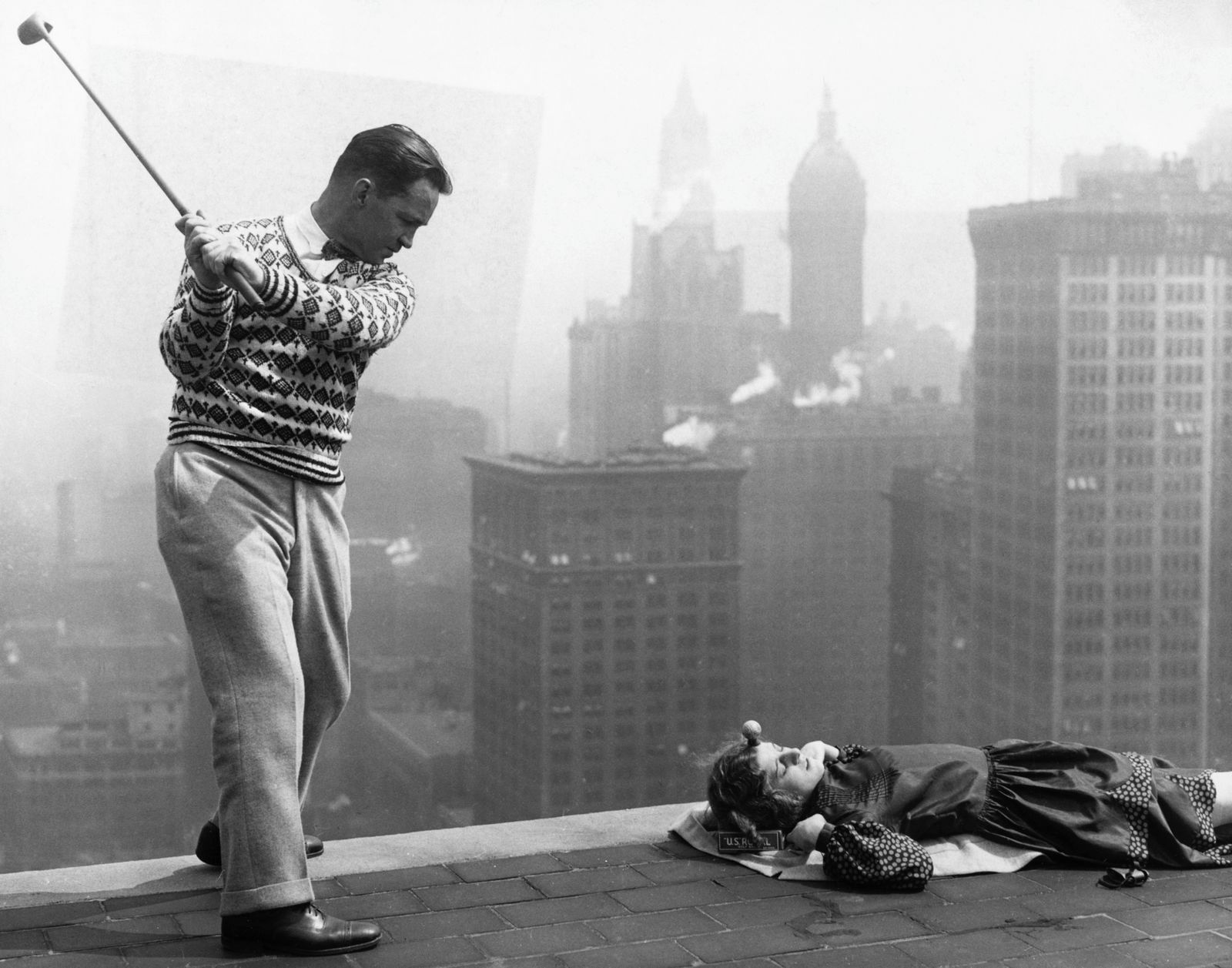 Jack Redmond - Man Swinging at Golf Ball on Woman's Forehead