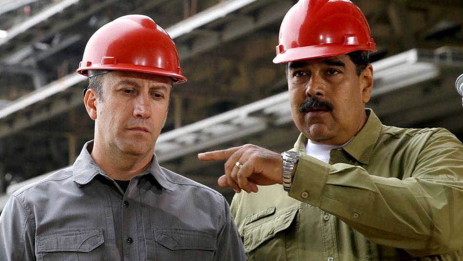 Industrieminister Tareck El Aissami und Staatschef Nicolás Maduro