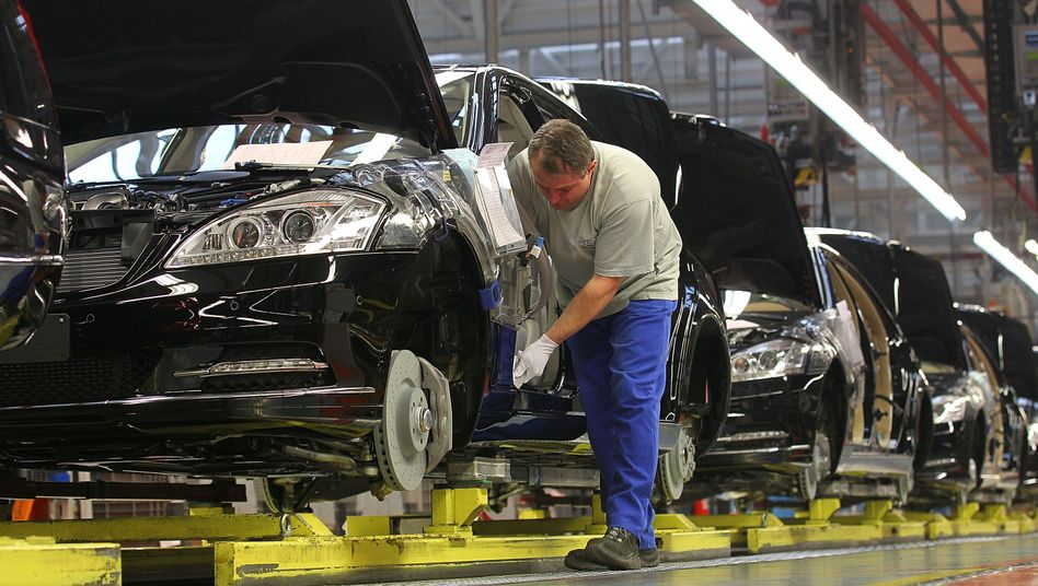 A worker at a Daimler factory in Germany. Auto sales in Germany dropped in September.