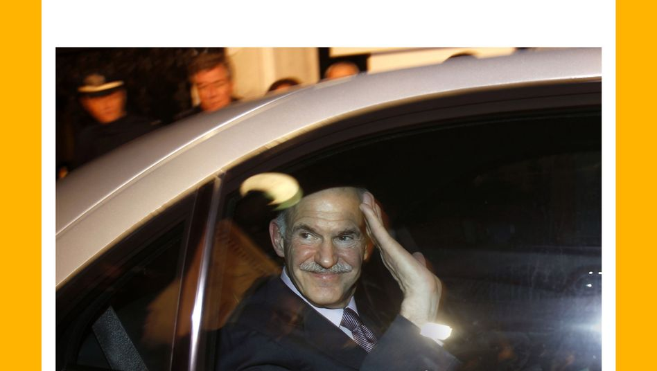 Greek Prime Minister Papandreou leaving the presidential palace on Sunday night.