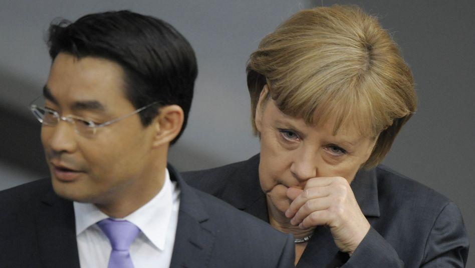 Vizekanzler Rösler, Kanzlerin Merkel: Passiert ist nichts