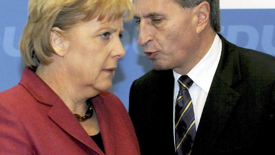 Kanzlerin Merkel, nominierter EU-Kommissar Oettinger: Dritte Wahl
