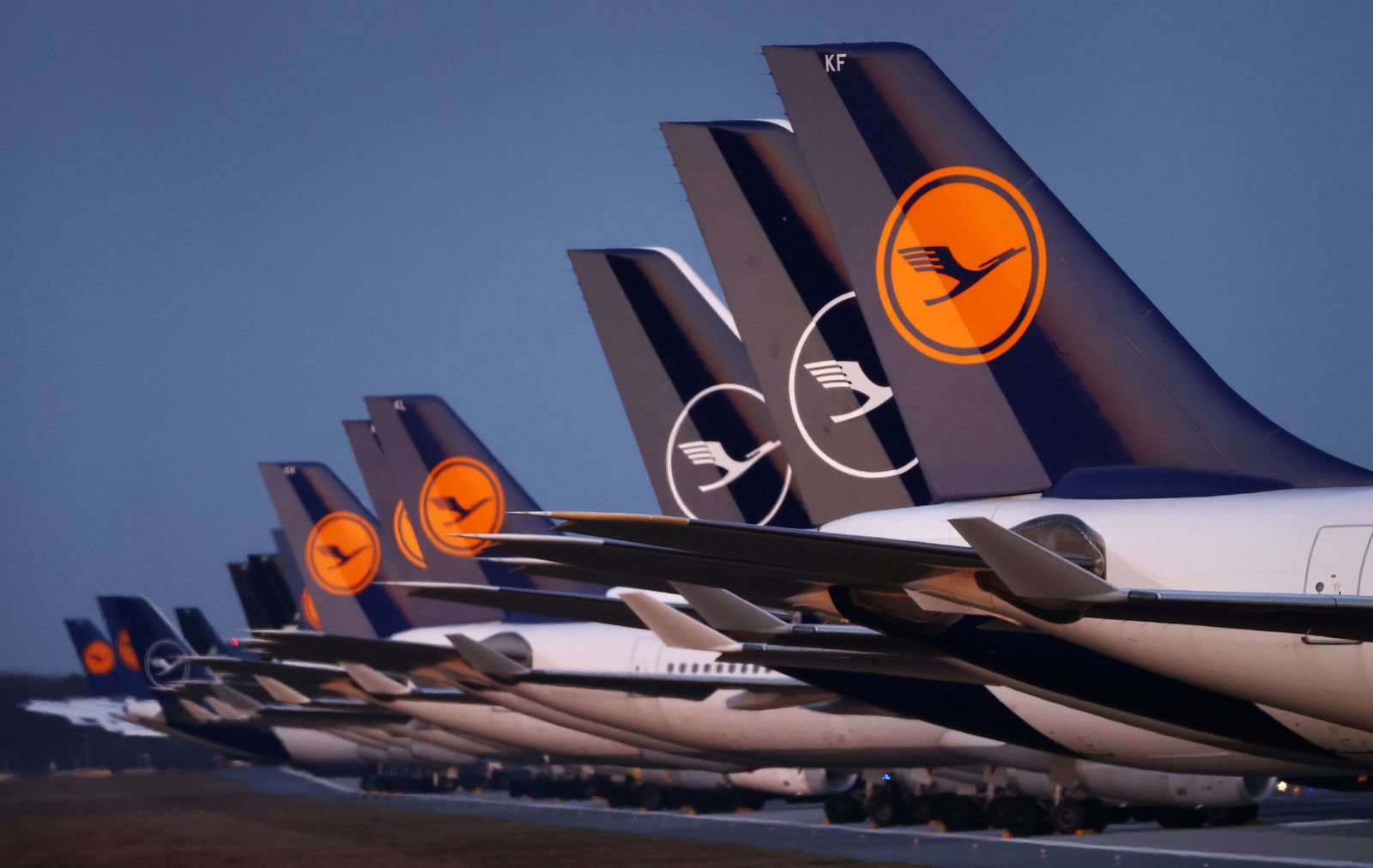 FILE PHOTO: Planes of German carrier Lufthansa parked on a closed runway at Frankfurt airport