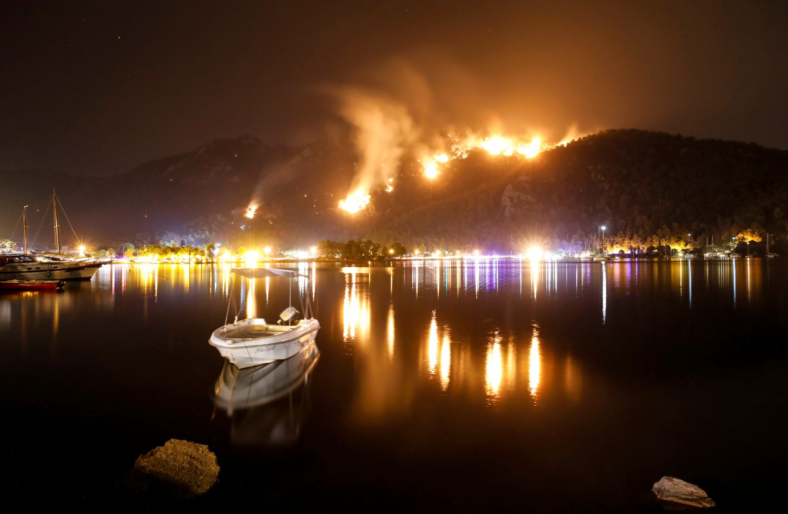 Flames and smoke rises from mountains in Orhaniye village near Marmaris