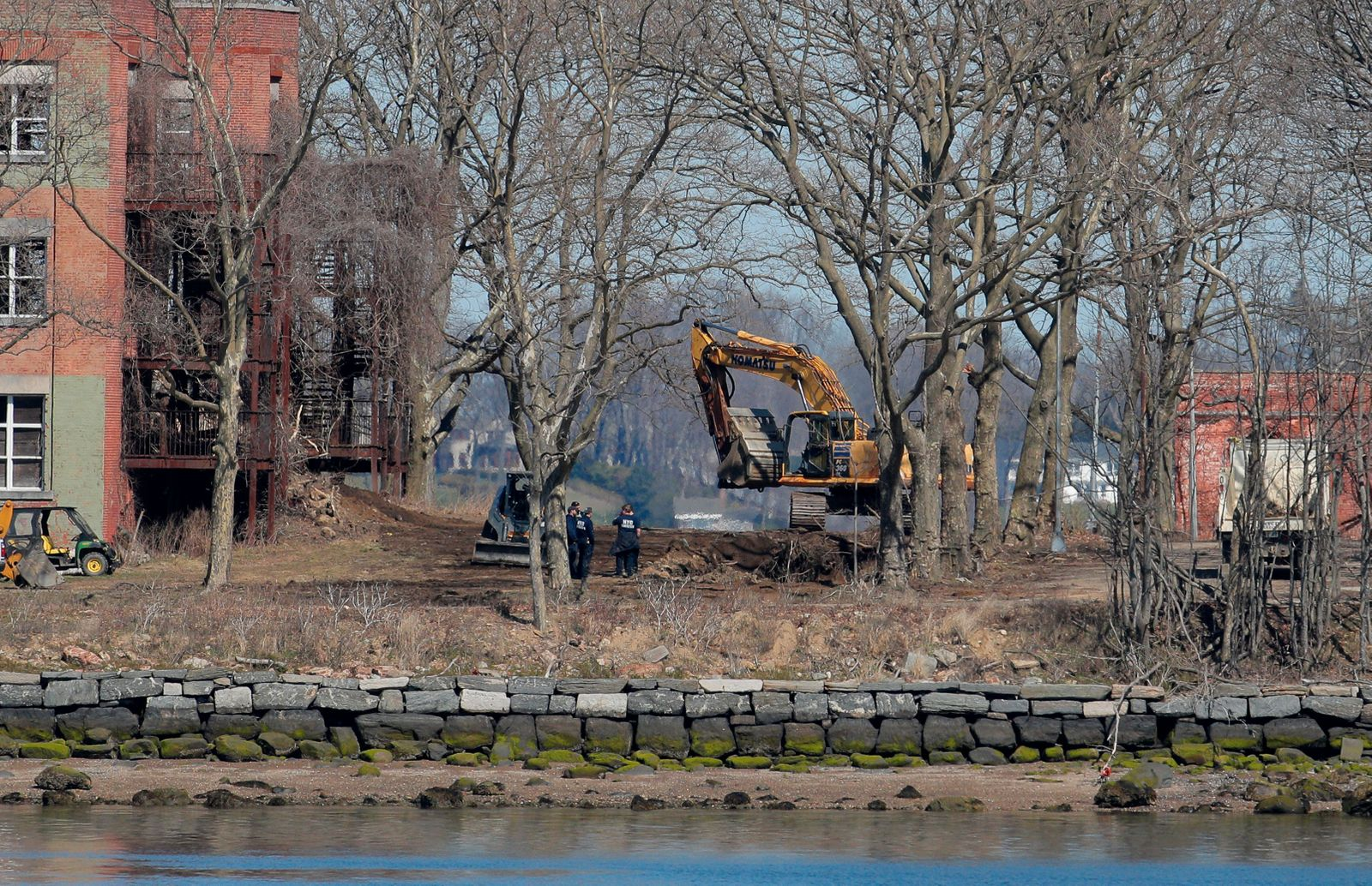 Workers are seen on Hart Island which New York city is considering as site for temporary interment of victims of coronavirus disease (COVID-19) in New York