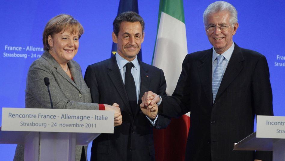 Friends: Angela Merkel and Nicolas Sarkozy make a show of strength with Italy's new prime minister, Mario Monti.