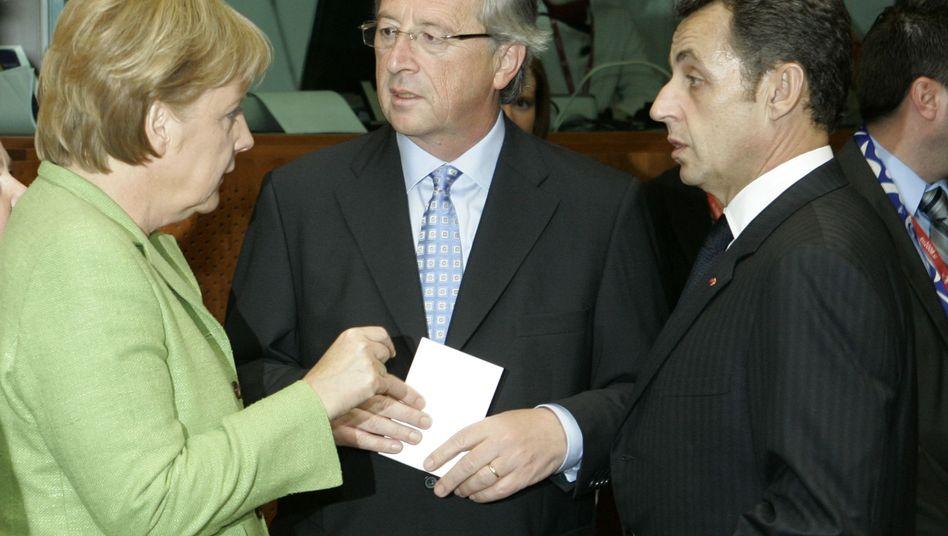 Merkel, Juncker, Sarkozy: Ein Staatsmann, zwei Verwalter nationaler Egoismen