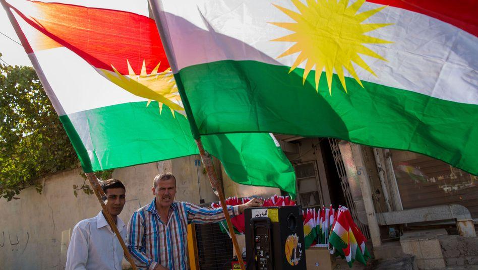 Flaggenverkäufer in Arbil: Steinmeier lehnt die Gründung eines kurdischen Staates ab