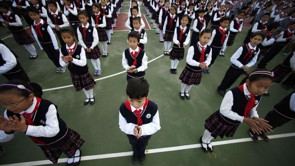 """Mitglieder der """"Jungen Pioniere"""": China hofft nach Gesetzesänderung auf mehr Nachwuchs"""