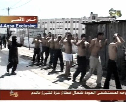 """Hamas fighters escort Fatah members out of the Preventative Security headquarters in Gaza: """"Absolute chaos."""""""