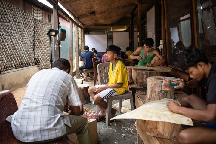 "Children in ""Little Angels"" making leatherworks for tourists."