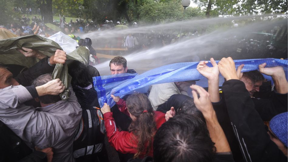 A police water cannon fires into the crowd at a protest over the bitterly contested Stuttgart 21 project in the southern German city.