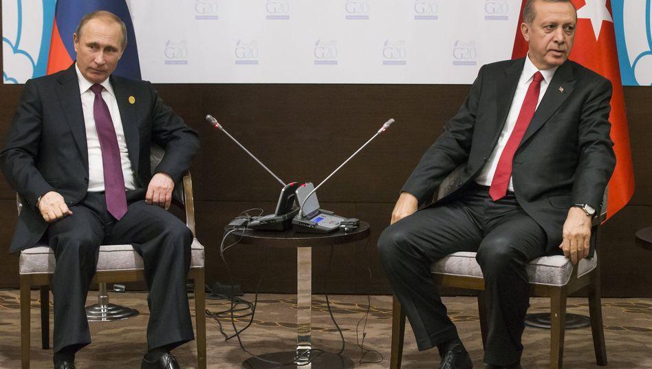 Präsidenten Putin (l.), Erdogan