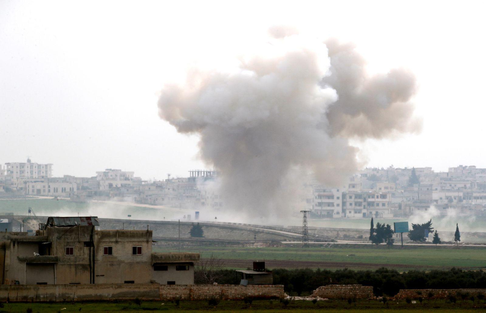 Smoke rises after an air strike in Saraqeb in Idlib province