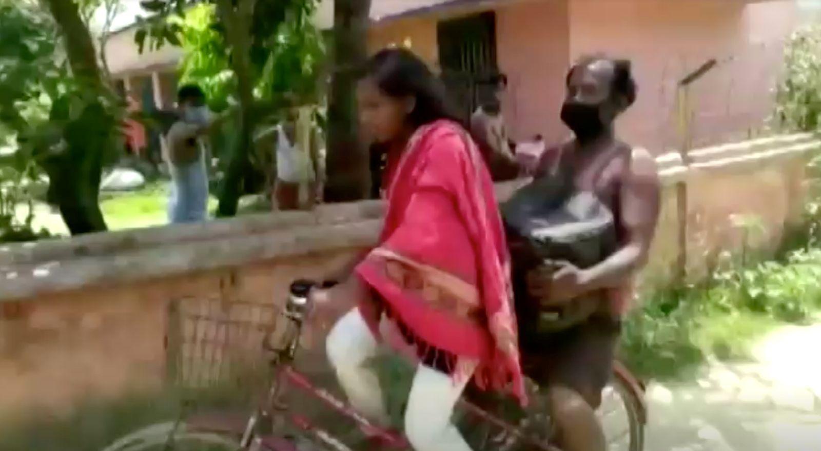 Jyoti Kumari carries her father on the back of her bicycle, in Darbhanga