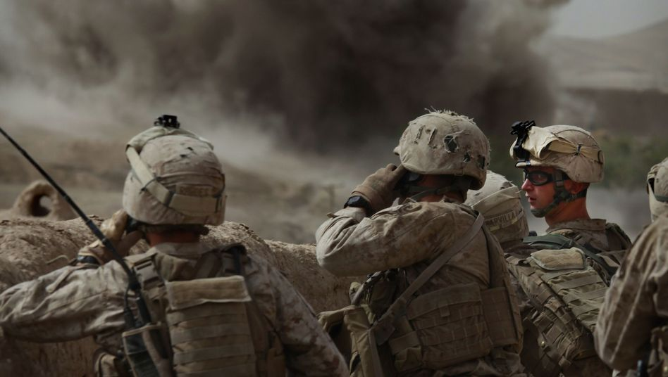 US soldiers watching an air strike they called in during a gun battle in southern Afghanistan, July 23, 2010.