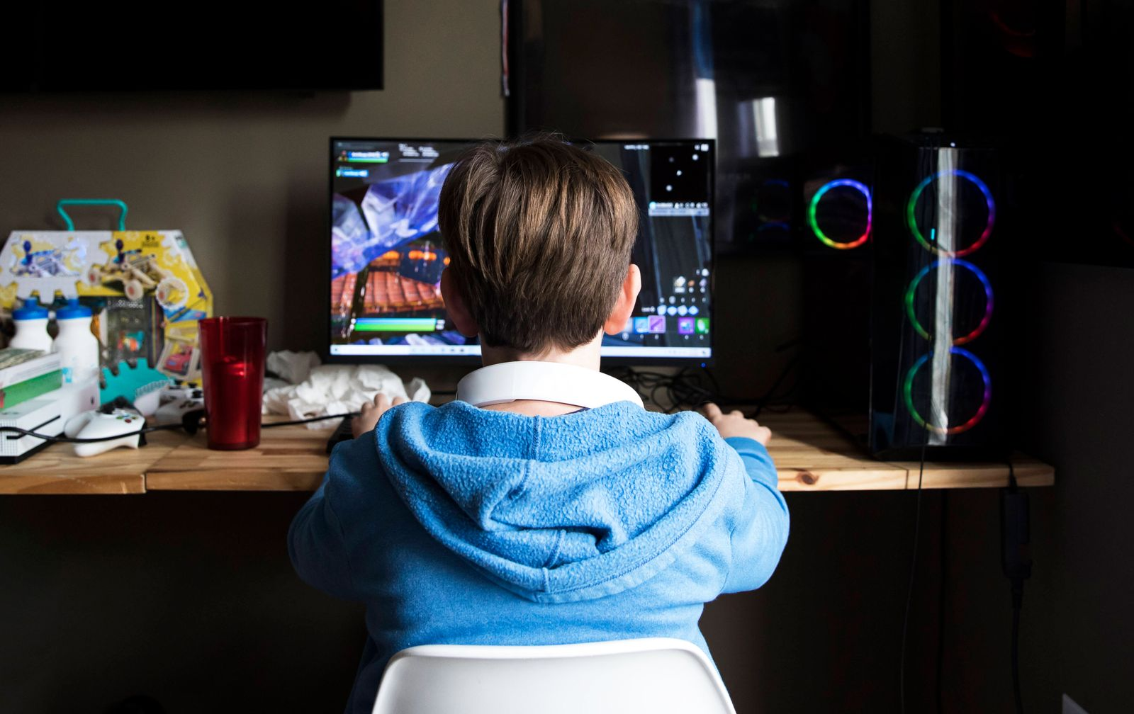 Rear View of Teen Boy Playing On Gaming Computer At Messy Desk Easton, MD, United States PUBLICATIONxINxGERxSUIxAUTxONLY